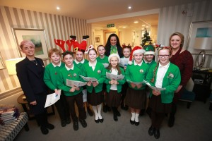 McCarthy & Stone Sales Support Executive Rachael Hardley, Sales Executive Sharon Robinson and House Manager Joanne Barlow with pupils from St Francis Catholic Primary School. credit:  leeboswellphotography.com